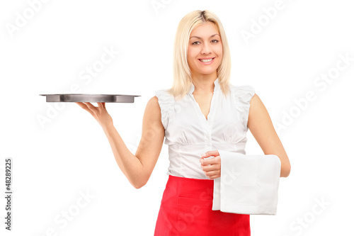 A smiling female waitress holding a tray