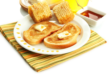 White bread toastwith honey on plate, isolated on white