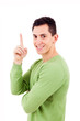 Portrait of happy young man pointing upwards over white backgrou