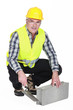 Bricklayer in a reflective vest