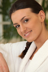 brunette wearing bathrobe