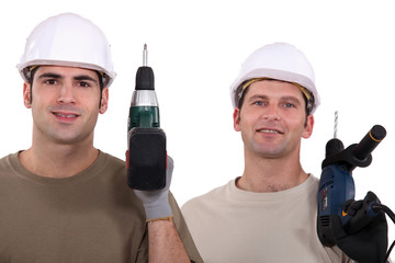 duo of electricians holding drill