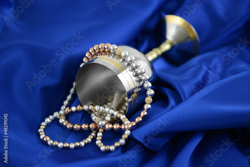 Gold silver and pearls on a blue silk