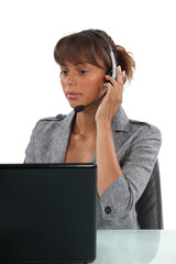 Receptionist wearing head-set