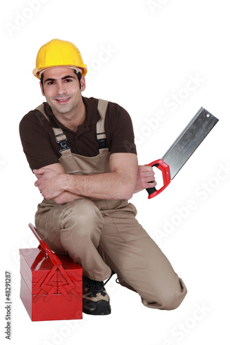 Laborer with saw and toolbox