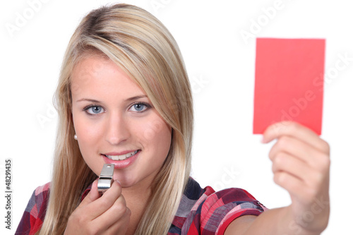 woman holding a red card