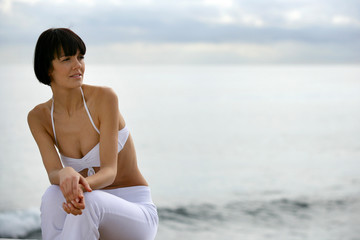 Contemplative woman by the sea