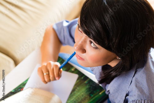 Girl with pile of books learning