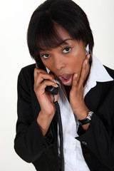 Shocked woman taking on the phone