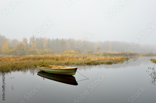 river and a boat scene during Fall season - 48292247