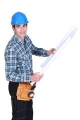 portrait of foreman holding blueprints