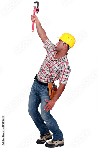 Laborer trying to hang on with a caliper