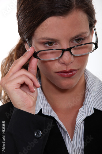 Serious businesswoman wearing glasses