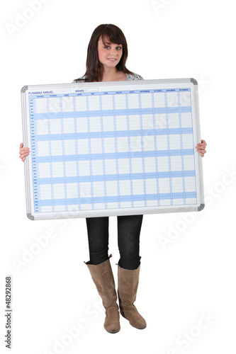 Young woman with a planning board