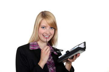 Attractive woman looking at her agenda