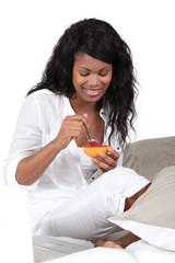 Woman eating grapefruit