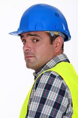 A nervous-looking tradesman