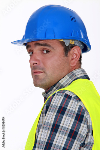 A nervous-looking tradesman