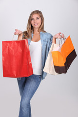 Young girl with store bags full of shopping