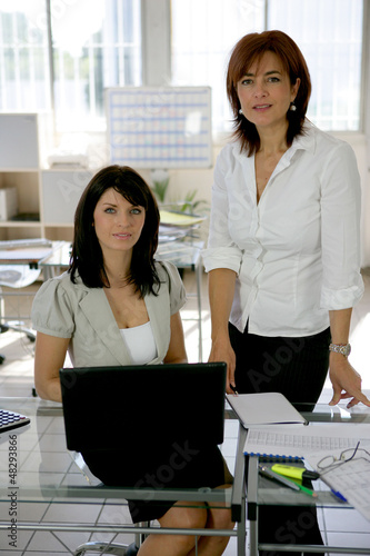 two businesswomen working at the office