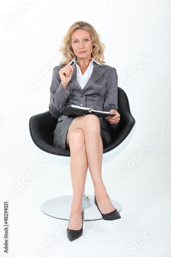 Blond executive sat in chair