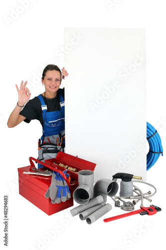 plumber woman OK sign