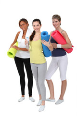 Woman holding gym mats