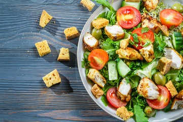 Healthy Caesar salad made of fresh vegetables and chicken