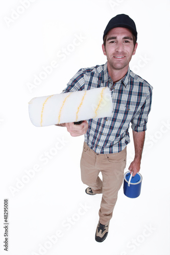 Man with a clean paint roller