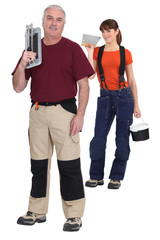 Tiler and young female assistant