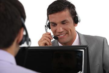 Businessmen wearing headsets