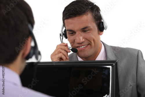 Businessmen wearing headsets