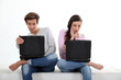 Young couple with their laptops