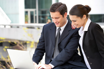 Business couple with a laptop computer