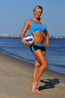 A sporty fit woman  holding a volleyball ball