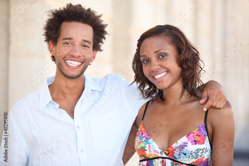 Smiling couple embracing