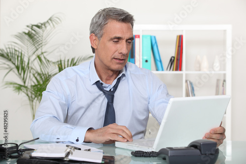 mature businessman working on his desk