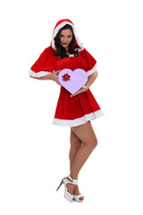 Woman dressed in seductive Santa costume