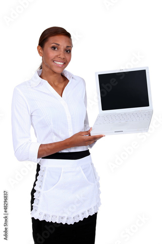 Waiter holding laptop