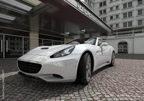 weißer sportwagen vor hotel