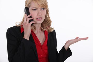 Blond having telephone dispute