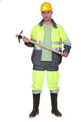 A man holding a pickaxe.