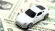 Expenses on new car. Rack focus.