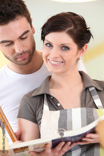 Couple looking at a cookbook