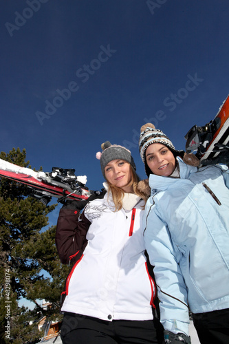Two female friends skiing