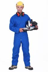 Handyman holding a circular saw