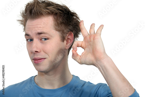 young man making okay sign