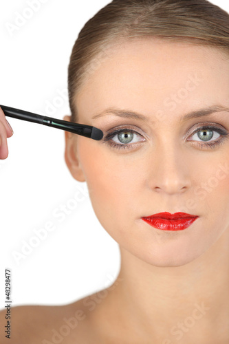 Sophisticated girl making-up