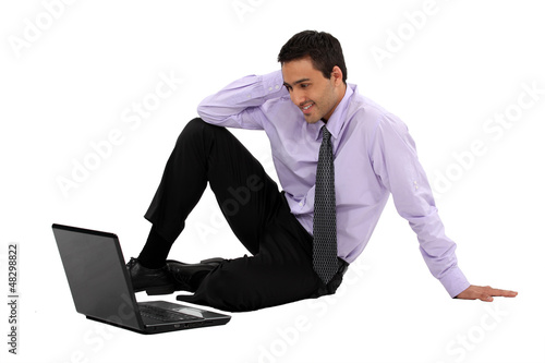 Businessman watching a movie on his laptop