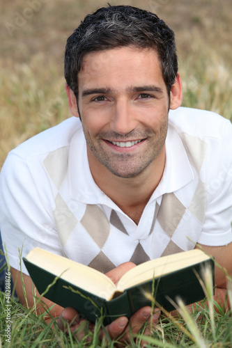 Man reading on the grass
